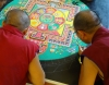 The monks added dozens of tiny items to the mandala today, from bitty snow lions to blossoming lotus flowers.
