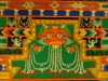 """The zimba is the mandala's monster. He is a fantastical creature that is a cross between a lion and a crocodile. Holding his jewels, he is a reminder to keep moral consistency and watch your words. Next to him are two thumbnail-sized snow lions, holding up """"the pillars."""""""