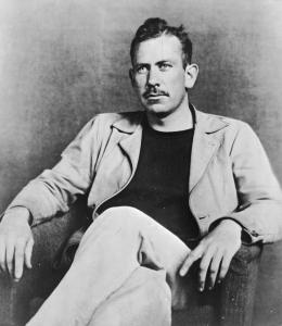 John Steinbeck sitting in a chair